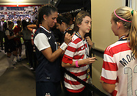 BOCA RATON, FL - DECEMBER 15, 2012: Shannon Boxx (7) of the USA WNT signs autographs at the end of an international friendly match against China  at FAU Stadium, in Boca Raton, Florida, on Saturday, December 15, 2012. USA won 4-1.