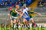 Michael O'Leary and Johnny Buckley Kerry try to stop Barry coughlan Waterford during their clash in Fitzgerald Stadium on Saturday