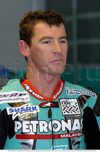 TROY CORSER (AUS), Foggy Petronas, in the pit area after qualifying practice, Superbike World Championship Race, Ricardo Tormo Circuit, Valencia, 030228. Photo:Neil Tingle/Action Plus ...2003  .man men superbikes motorcycle motorcycles bike bikes.portrait portraits.     . ...  ..