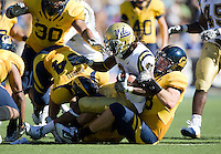 September 4, 2010: Mike Mohamed and J.P. Hurrell of California brings down Josh Smith of UCLA during a game at Memorial Stadium in Berkeley, California.   California defeated UCLA 35-7