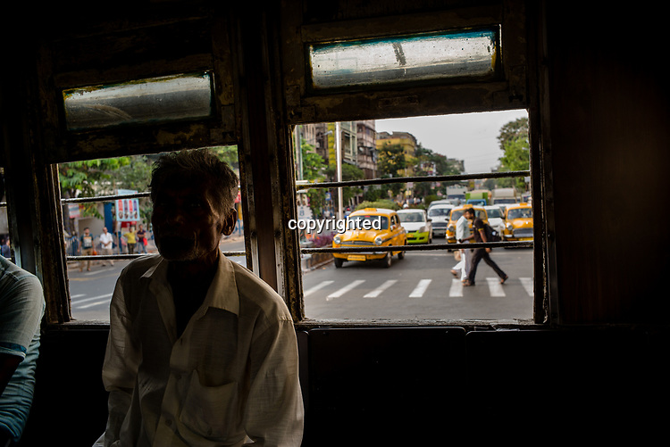 Computers travel on a tram in Kolkata, India, on Friday, May 26, 2017. Photographer: Sanjit Das