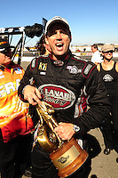 Jul. 18, 2010; Sonoma, CA, USA; NHRA top fuel dragster driver Larry Dixon celebrates after winning the Fram Autolite Nationals at Infineon Raceway. Mandatory Credit: Mark J. Rebilas-