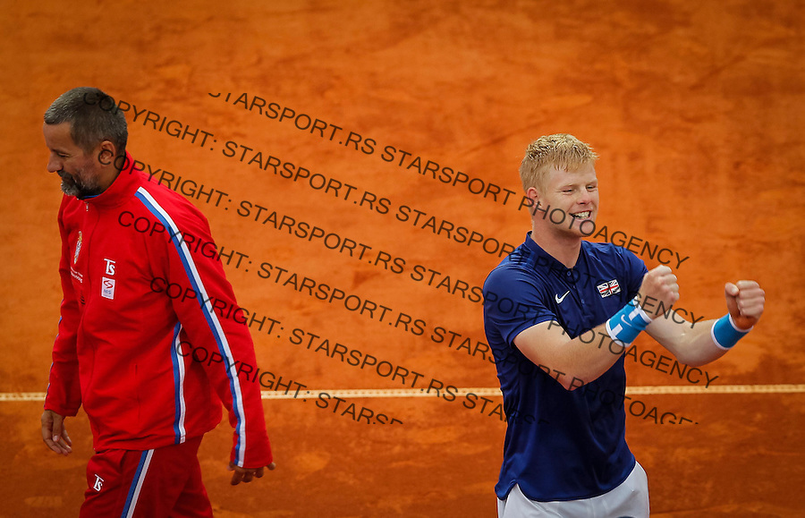 BELGRADE, SERBIA - JULY 17: Kyle Edmund (R) of Great Britain celebrates victory near team captain Bogdan Obradovic (L) of Serbia  after day three of the Davis Cup Quarter Final match between Serbia and Great Britain on Stadium Tasmajdan on July 17, 2016 in Belgrade, Serbia. (Photo by Srdjan Stevanovic/Getty Images)