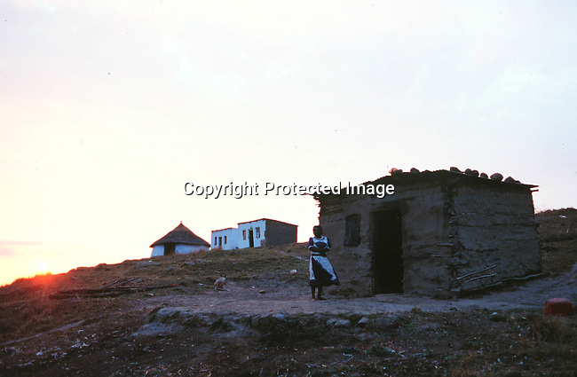 lsrural30076 Kwa-Zulu Natal. A woman standing in front of her shack/hut 1999 Mud hut.©Per-Anders Petterson/iAfrika Photos