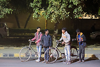 Boys and bikes stand by the roadside near HUDA City Centre in Gurugram, Haryana, India, on Mon., December 10, 2018.