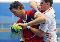 08 JAN 2012 - LONDON, GBR - Great Britain right back Steve Larsson (left, in red) battles to keep the ball during the men's 2013 World Handball Championships qualification match against Austria at the National Sports Centre in Crystal Palace, Great Britain .(PHOTO (C) 2012 NIGEL FARROW)