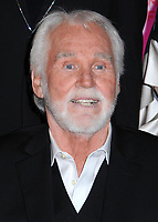 """20 March 2020 - Kenny Rogers, whose legendary music career spanned nearly six decades, has died at the age of 81. Rogers was inducted to the Country Music Hall of Fame in 2013."""" He had 24 No. 1 hits and through his career more than 50 million albums sold in the US alone. He was a six-time Country Music Awards winner and three-time Grammy Award winner. Some of his hits included """"Lady,"""" """"Lucille,"""" """"We've Got Tonight,"""" """"Islands In The Stream,"""" and """"Through the Years."""" His 1978 song """"The Gambler"""" inspired multiple TV movies, with Rogers as the main character. File Photo: 29 February 2016 - Nashville, Tennessee - Kenny Rogers. T.J. Martell Foundation 8th Annual Nashville Honors Gala held at the Omni Hotel. Photo Credit: Laura Farr/AdMedia"""