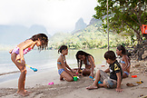 FRENCH POLYNESIA, Moorea. Kids playing and swimming by Opunohu Bay.