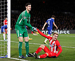 Thibaut Courtois of Chelsea helps up Antoine Griezmann of Atletico Madrid during the Champions League Group C match at the Stamford Bridge, London. Picture date: December 5th 2017. Picture credit should read: David Klein/Sportimage