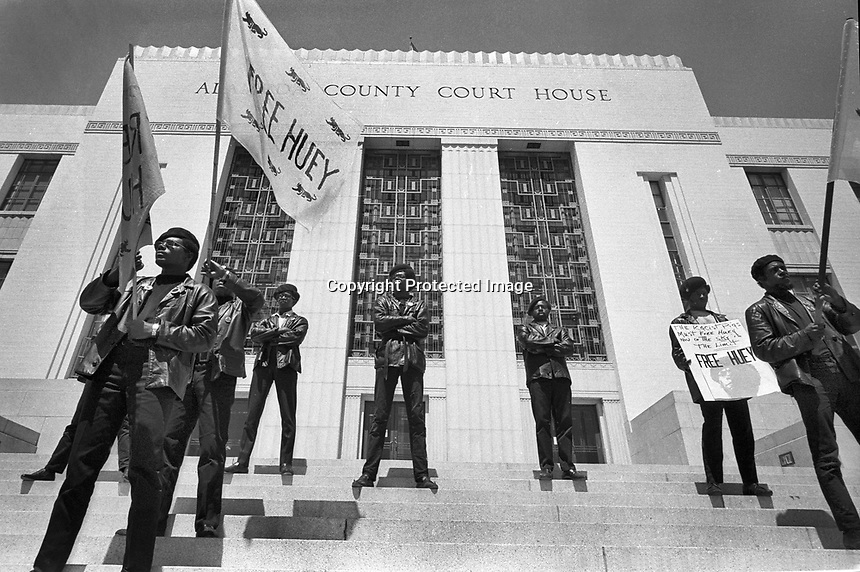Black Panthers standing on the steps of the Alameda County court housein Oakland California protesting &quot;Free Huey&quot; Newton who is jailed inside. (copyright @<br />