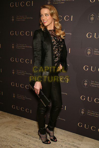 AMBER HEARD .attend The Society of Memorial Sloan-Kettering Cancer Center's Annual Fall Party at the Four Seasons Restaurant, New York, NY, USA, .November 16th, 2010.full length black jacket lace top trousers blazer peep toe shoes ankle boots sandals beige sheer see thru through .CAP/LNC.©TOM/LNC/Capital Pictures.