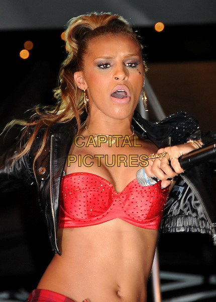 """THE PUSSYCAT DOLLS - MELODY THORNTON.The Pussycat Dolls Celebrate the release of their new album """"Doll Domination"""" with a free concert at Hollywood & Highland, Hollywood, California, USA..September 23rd, 2008.half length singing stage concert live gig performance red bra cleavage beads beaded mouth open belly stomach midriff .CAP/ADM/BP.©Byron Purvis/AdMedia/Capital Pictures."""