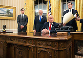 United States President Donald Trump prepares to sign a confirmation for Defense Secretary James Mattis in the Oval Office at the White House in Washington, D.C. on January 20, 2017.    <br /> Credit: Kevin Dietsch / Pool via CNP