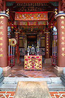 The Shrine of the Serene Light, tucked away at the end of an alley off Phang Nga Road is one of Old Phuket's treasures.Taoist etchings on the walls and the vaulted ceiling is well stained from incense plumes, The altar is alive with fresh flowers and burning candles. The shrine was built by a local Hokkien Chinese family in the mid 1885.