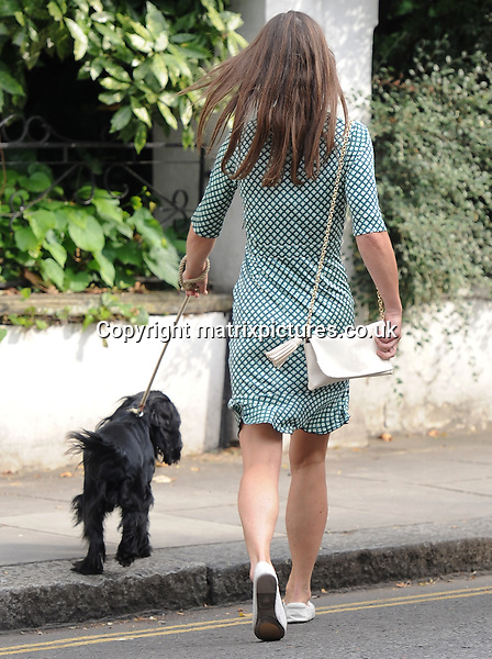 NON EXCLUSIVE PICTURE: MATRIXPICTURES.CO.UK<br /> PLEASE CREDIT ALL USES<br /> <br /> WORLD RIGHTS<br /> <br /> Newly engaged socialite Pippa Middleton is spotted out and about while walking her dog in west London. <br /> <br /> The 32-year-old, who looks chic wearing a geometric print dress, shows off her huge &pound;200,000 engagement ring. <br /> <br /> JULY 21st 2016<br /> <br /> REF: LTN 162401