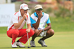 Oscar Floren (SWE) and caddy line up his putt on the 18th green during Day 2 Friday of the Open de Andalucia de Golf at Parador Golf Club Malaga 25th March 2011. (Photo Eoin Clarke/Golffile 2011)