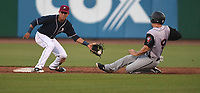 NWA Democrat-Gazette/J.T. WAMPLER NWA Naturals' Nicky Lopez catches Arkansas Travelers' Dario Pizzano at second base Monday May 14, 2018 at Arvest Ballpark in Springdale.