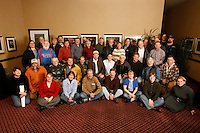 The Iditarod Airforce Volunteer pilots, load coordinators and logistcs volunteers pose for a group photo at the Millenium hotel in Anchorage.  These pilots fly thousands of hours in order to haul, food, fuel, vets, checkers, dropped dogs and officials along the 1200 miles of the race trail.    Iditarod 2009