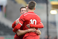 Pictured: Gwion Roberts of Wales (L) celebrating his equaliser. Monday 19 May 2014<br />