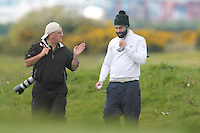 Thos Caffrey (Golffile) and Sean Ryan (The Royal Dublin) on the 14th during Round 3 of The Irish Amateur Open Championship in The Royal Dublin Golf Club on Saturday 10th May 2014.<br /> Picture:  Thos Caffrey / www.golffile.ie