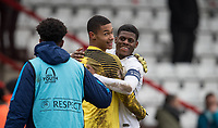 Goalkeeper Brandon Austin of Spurs U19 embraces Timothy Eyoma (right)  of Spurs U19 at full time during the UEFA Youth League round of 16 match between Tottenham Hotspur U19 and Monaco at Lamex Stadium, Stevenage, England on 21 February 2018. Photo by Andy Rowland.
