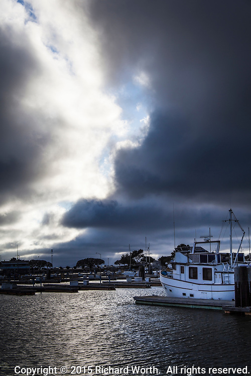 Dramatic clouds fill the sky over the San Leandro Marina, and then they part, on San Francisco Bay.