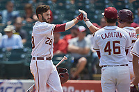 Dylan Busby (28) of the Florida State Seminoles is greeted by teammates after hitting a home run against the Duke Blue Devils in the first semifinal of the 2017 ACC Baseball Championship at Louisville Slugger Field on May 27, 2017 in Louisville, Kentucky. The Seminoles defeated the Blue Devils 5-1. (Brian Westerholt/Four Seam Images)