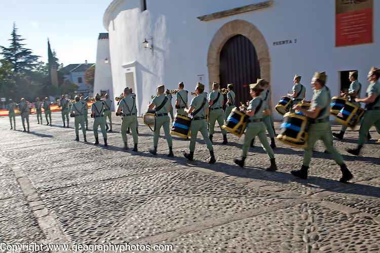 Soldiers military band parade march for national day celebration, Ronda, Spain