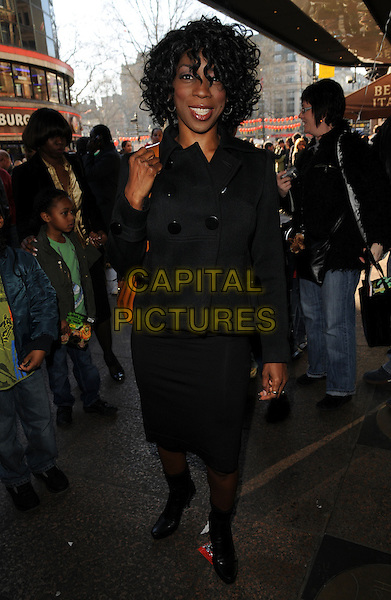 "HEATHER SMALL.""Ben 10: Race Against Time"" UK film premiere, Vue West End, London, England..February 10th, 2008.full length black jacket boots skirt.CAP/CAN.©Can Nguyen/Capital Pictures"