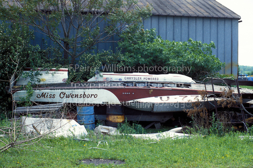 "U-77 ""Miss Owensboro"", The former ""Chrysler Crew"" twin 426 HEMI powered hull of Bill Sterett at rest behind the ""The Boathouse"" of George Walther. Walther purchased the boat only to get the U number ""77"" in the early 70's, with no intention of running the boat it just rotted away behind the West Carrollton, Ohio business. 1983..© F. Peirce Williams 1983"