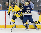 Carter Madsen (Merrimack - 9), Billy Maday (Notre Dame - 17) - The University of Notre Dame Fighting Irish defeated the Merrimack College Warriors 4-3 in overtime in their NCAA Northeast Regional Semi-Final on Saturday, March 26, 2011, at Verizon Wireless Arena in Manchester, New Hampshire.