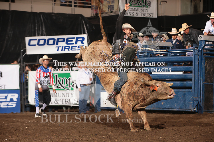 Tyler Harr attempts to ride Dakota Rodeo/chad Berger/Clay Struve's Yesterday's Wine during the second round of the Bismarck Real Time Pain Relief Velocity tour PBR. Photo by Andy Watson