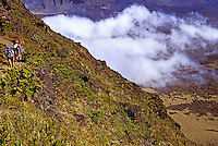 Hikers enjoy the spectacular scenery inside the crater at Haleakala National Park on the island of Maui.