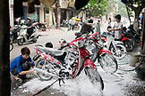 VIETNAM, Hanoi, boys wash, detail and clean mopeds