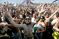 INDIO, CA - APRIL 26, 2008:  Clammering for a litthe relief fron the heat, festival goers are asking tpo be sprayed with water in the DOLAB area at Coachella April 26.  This is the 9th annual Coachella Valley Music and Arts Festival in Indio. CA. held on April 25-27, 2008.  Photo by Spencer Weiner and Jay L. Clendenin.