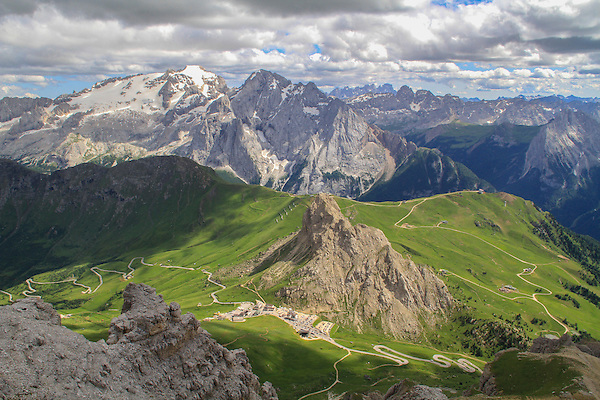 Italy, Dolomites.<br /> Photographers instinctively climb to high points to get the shot. The Alps have many more ski lifts than North American ski area, plus they're open in the summer. <br /> Atop the Sella Groupa Tram, with Passo Pordoi and Mt Marmolada in view, Italy.