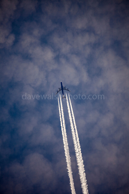 Airliner with contrails, above the Pyrenees, France.<br /> <br /> Aviation is one of the fastest growing sources of greenhouse gas (GHG) emissions and the most climate-intensive form of transport. Aviation emissions have more than doubled in the last 20 years and the sector is responsible for an estimated 4.9% of man-made global warming - and growing 21% in EU in last three years). While other sectors are working to decarbonise, there's no sign of any viable alternative to fossil fuelled flight anytime soon - electric engines are a long way off. Flying seems, cheap, and it seems easy, but it's actually expensive - and we've yet to pay the cost. In the EU, many tickets are VAT-exempt, costing governments €17 billion annually. If applied, tickets would cost, around 20% or so extra, depending on where you live. Plus, Fuels used in commercial aviation are exempt from excise duties in the EU. (Facts from Transport & Environment website).