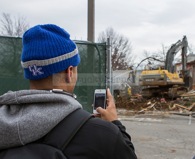 Senior UK Guard Twany Beckham stops and snaps a picture with his phone of Joe B. Hall Wildcat Lodge. Beckham had lived in the Lodge. in Lexington, Ky., on Monday, November, 26, 2012. Photo by James Holt   Staff