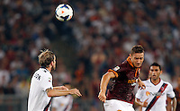 Calcio, Serie A: Roma vs Bologna. Roma, stadio Olimpico, 29 settembre 2013.<br /> AS Roma forward Francesco Totti, right, heads the ball past Bologna defender Mikael Antonsson, of Sweden, during the Italian Serie A football match between AS Roma and Bologna at Rome's Olympic stadium, 29 September 2013.<br /> UPDATE IMAGES PRESS/Riccardo De Luca