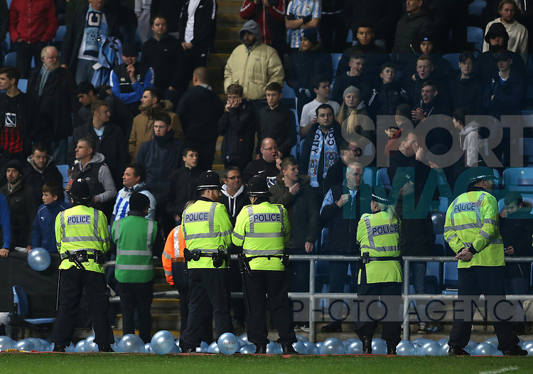 Police try to contain the Coventry fans during the English League One match at the Rioch Arena Stadium, Coventry. Picture date: December 15th, 2016. Pic Simon Bellis/Sportimage