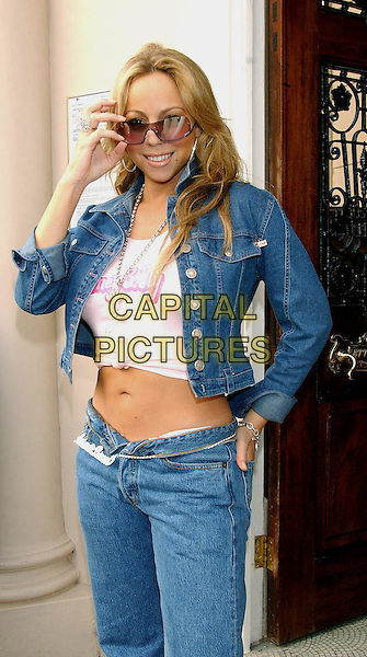 MARIAH CAREY.At 5 Cavendish Square party.www.capitalpictures.com.©Capital Pictures.cropped denim jacket, knotted tshirt, midriff, chain belt