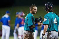 AZL Mariners catcher Manny Pazos (21) talks to Connor Hoover (4) during the game against the AZL Cubs on August 4, 2017 at Sloan Park in Mesa, Arizona. AZL Cubs defeated the AZL Mariners 5-3. (Zachary Lucy/Four Seam Images)