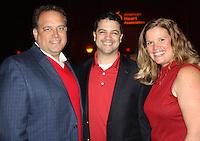 NWA Democrat-Gazette/CARIN SCHOPPMEYER Joe Mueller (from left), Alex Vasquez and Jennifer Hawkins help support the American Heart Association at Go Red.