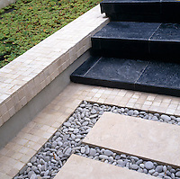 Detail of different material used sandstone tiles, pebbles and slate