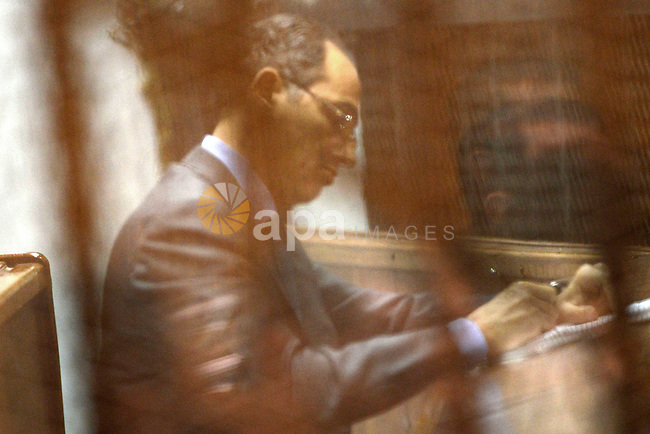 "Gamal Mubarak, the son of former former president Hosni Mubarak sits in a courtroom cage during his retrial in Cairo on April 16, 2015. Cairo Criminal Court held at Police Academy will resume, Gamal and Alaa Mubarak trial in ""Stock Market Manipulation"" case. Gamal and Alaa Mubarak and six other businessmen, who are officials and former members of the board of directors of the National Bank face charges of illegal gains from the sale of National Bank of Egypt, waste of public money, causing huge losses to the economy and destroying the country's banking system through manipulating the stock exchange. Photo by Stringer"