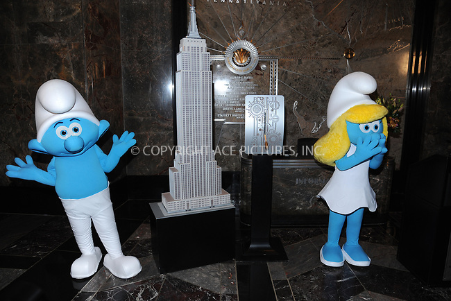 www.acepixs.com<br /> March 20, 2017  New York City<br /> <br /> Smurfs attending a lighting ceremony at The Empire State Building to celebrate the 'Small Smurfs Big Goals' campaign and the International Day Of Happiness on March 20, 2017 in New York City.<br /> <br /> Credit: Kristin Callahan/ACE Pictures<br /> <br /> Tel: 646 769 0430<br /> Email: info@acepixs.com