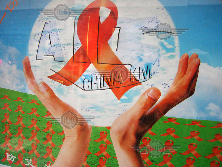 Billboard featuring the red ribbon as part of an AIDS awareness campaign....