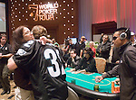 Dorey Borden of the Borgata tournament staff, hugs Eric Bankoff, after he was knocked out.