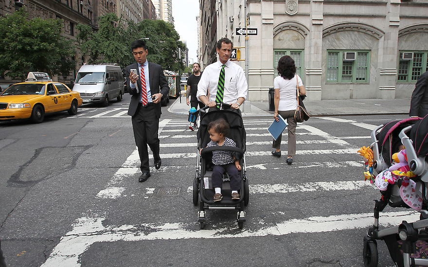Mayoral candidate Anthony Weiner with son Jordan on his way to  vote in the New York City Mayoral Primary on Tuesday, Sept. 10, 2013 New York. (AP Photo/ Donald Traill)