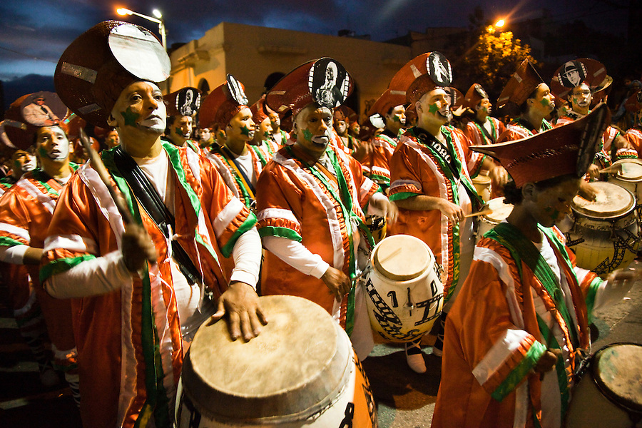 A drum battery performs during the parade of Llamadas in Montevideo.  One of the most imporant elements of Carnaval in Uruguay is Candombe, an African drum rhythm played on tambor drums.  It was revitalized in the Americas by black slave descendents as a way by which to reclaim their cultural heritage and battle for civil rights.